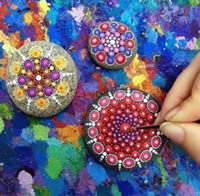 Painting rocks with patio paint in the mandala style